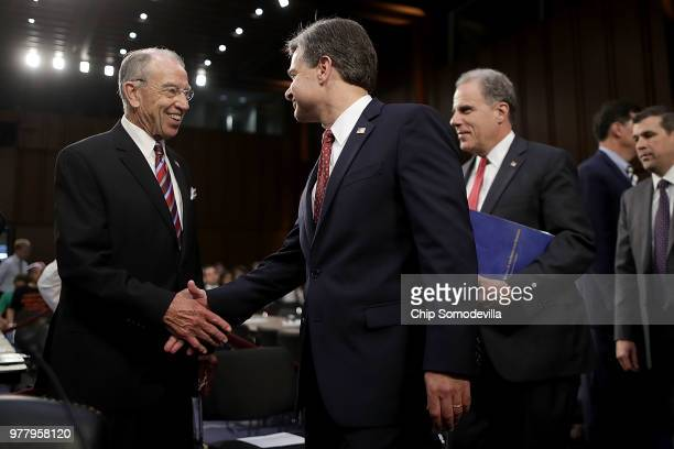 Senate Judiciary Committee Chairman Charles Grassley greets Federal Bureau of Investigation Director Christopher Wray and Justice Department...