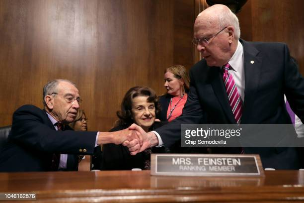 Senate Judiciary Committee Chairman Charles Grassley shakes hands with committee member Sen. Patrick Leahy as they and raking member Sen. Dianne...