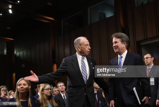 Senate Judiciary Committee Chairman Chuck Grassley leads Supreme Court nominee Judge Brett Kavanaugh to the witness table at the beginning of...