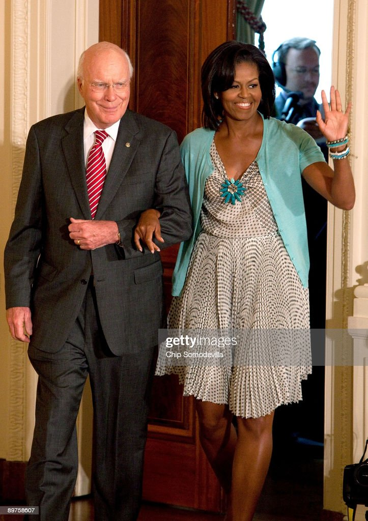 Senate Judiciary Committee Chairman Patrick Leahy (D-VT) (L) escorts first lady Michelle Obama during a reception for new Supreme Court Associate Justice Sonia Sotomayor in the East Room of the White House August 12, 2009 in Washington, DC. Sotomayor, who is the first Hispanic and the third woman to be appointed to the Supreme Court, is expected to begin hearing oral arguments with the other justices in September.