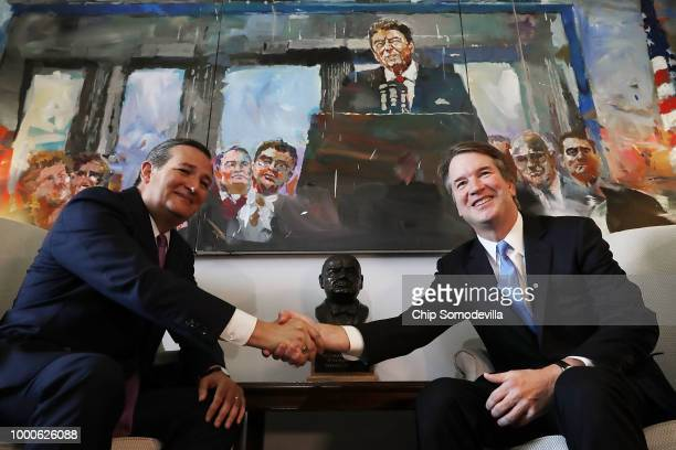 Senate Judiciary Committee member Sen Ted Cruz shakes hands and poses for photographs with Supreme Court nominee Judge Brett Kavanaugh in Cruz's...