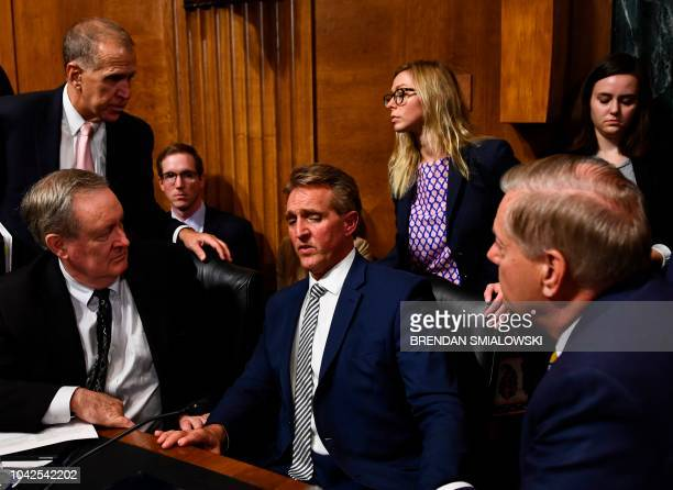 TOPSHOT Senate Judiciary Committee member Senator Jeff Flake speaks with colleagues after a hearing on Capitol Hill in Washington DC on September 28...