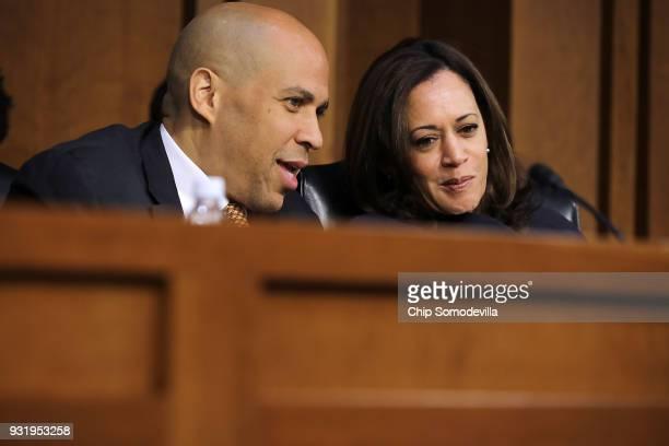 Senate Judiciary Committee members Sen Cory Booker and Sen Kamala Harris talk during a hearing about the massacre at Marjory Stoneman Douglas High...