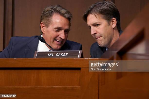 Senate Judiciary Committee members Sen Jeff Flake and Sen Ben Sasse talk during a hearing with US Attorney General Jeff Sessions in the Hart Senate...