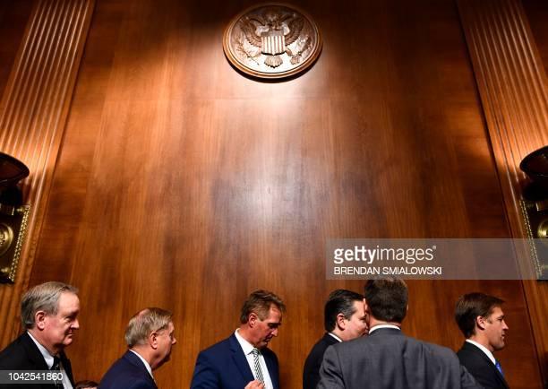 Senate Judiciary Committee members Senators Mike Crapo Lindsey Graham Jeff Flake Ted Cruz and Ben Sasse leave the room after a hearing on Capitol...