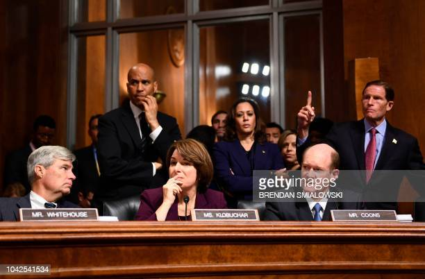 Senate Judiciary Committee members Sheldon Whitehouse Cory Booker Amy Klobuchar Kamala Harris Christopher Coons and Richard Blumenthal look on during...
