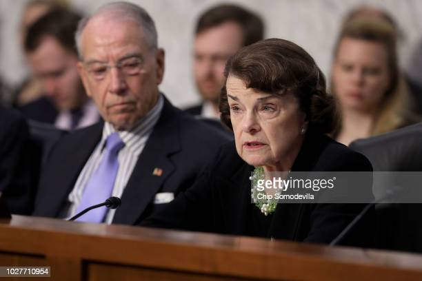 Senate Judiciary Committee ranking member Dianne Feinstein and Chairman Charles Grassley engage in a debate with fellow members of the committee...