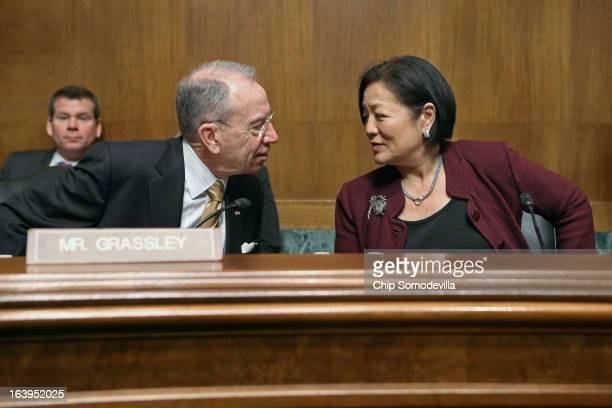 Senate Judiciary Committee ranking member Sen Charles Grassley and Sen Mazie Hirono visit before the start of a full committee hearing March 18 2013...