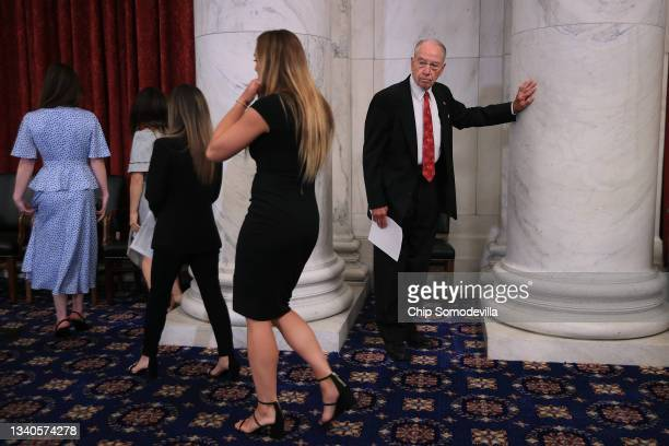 Senate Judiciary Committee ranking member Sen. Charles Grassley joins champion gymnasts for a news conference in the Russell Senate Office Building...