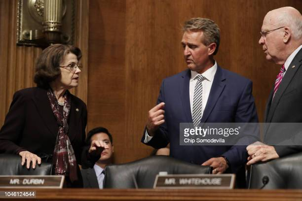 Senate Judiciary Committee ranking member Sen Dianne Feinstein and Sen Patrick Leahy negotiate with Sen Jeff Flake about his proposal to delay the...