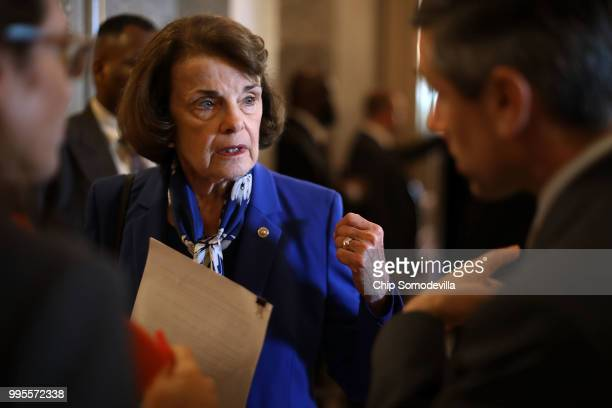 Senate Judiciary Committee ranking member Sen Dianne Feinstein talks with staff members outside the Senate chamber in the US Capitol July 10 2018 in...