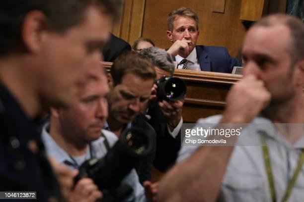 Senate Judiciary Committee Sen Jeff Flake listens to fellow committee members debate the confirmation of Supreme Court nominee Judge Brett Kavanaugh...