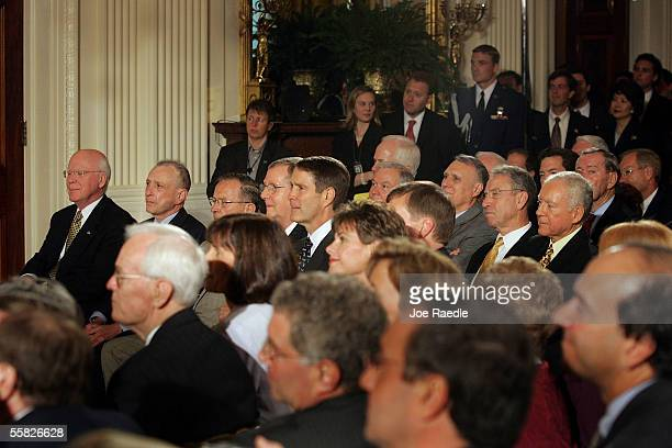 Senate Majority Leader Bill Frist sits with other law makers as they watch John Roberts being sworn in as the new Chief Justice of the U.S., during a...