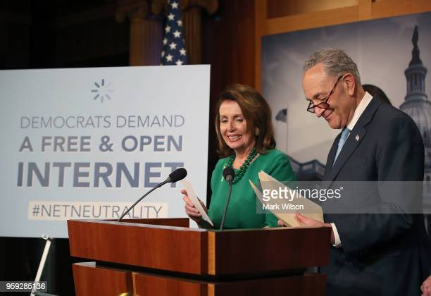 Senate Majority Leader Charles Schumer with House Minority Leader Nancy Pelosi looking on speaks at a press conference at the Capitol Building on May...