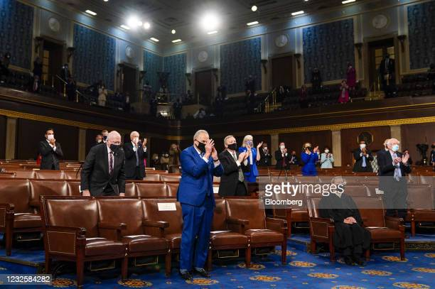 Senate Majority Leader Chuck Schumer, a Democrat from New York, left, reacts as U.S. President Joe Biden, not pictured, speaks during a joint session...