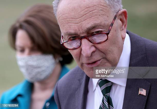 Senate Majority Leader Chuck Schumer , and Sen. Amy Klobuchar announce the introduction of S.1., the 'For the People' Act, outside the U.S. Capitol...