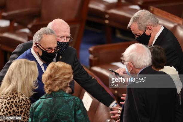 Senate Majority Leader Chuck Schumer confers with Senator Patrick Leahy , Senator Dick Durbin , Senator Bernie Sanders and other members of Congress...