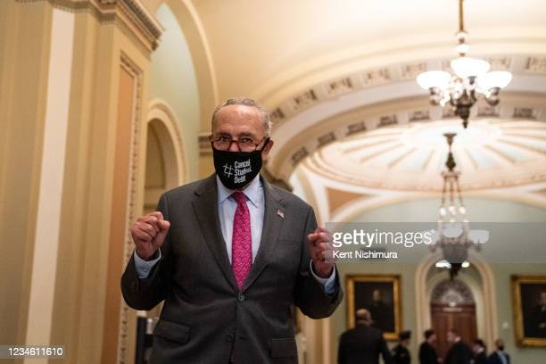 Senate Majority Leader Chuck Schumer outside the Senate Chamber celebrates the passage of H.R. 3684 Infrastructure Investment and Jobs Act on...