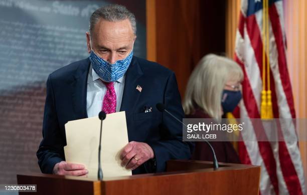 Senate Majority Leader Chuck Schumer speaks during a press conference at the US Capitol in Washington, DC on January 26, 2021. - The Senate trial of...