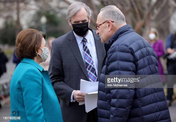 Senate Majority Leader Chuck Schumer , U.S. Senator Jeff Merkley and Sen. Amy Klobuchar confer before announcing the introduction of S.1., the 'For...