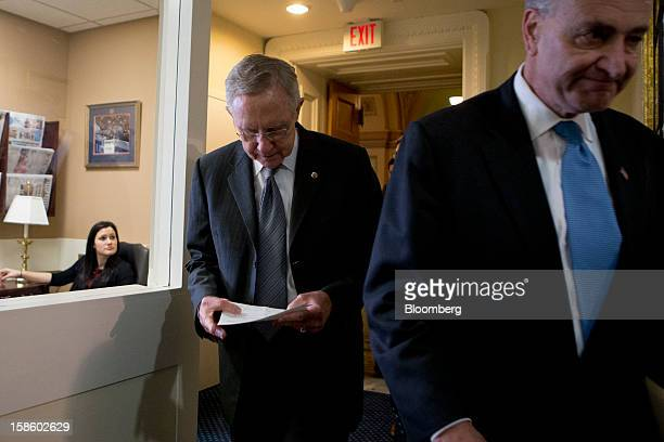 Senate Majority Leader Harry Reid a Democrat from Nevada left and Senator Charles Schumer a Democrat from New York right arrive to a news conference...