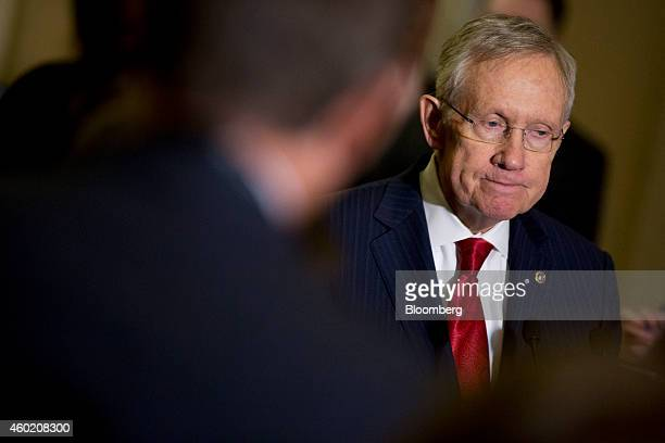 Senate Majority Leader Harry Reid a Democrat from Nevada pauses while speaking during a news conference in the US Capitol Building in Washington DC...