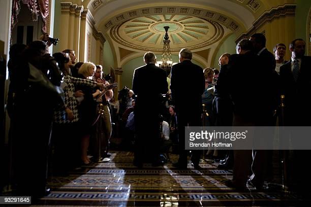 Senate Majority Leader Harry Reid and Sen Tom Harkin speak at a news conference following the Senate's cloture vote on health care reform legislation...