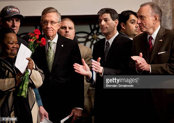 Senate Majority Leader Harry Reid and Senator Arlen Specter wait to speak during a rally on Capitol Hill February 24 2010 in Washington DC Supporters...