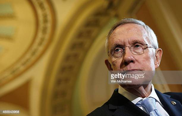 Senate Majority Leader Harry Reid answers questions following the weekly Democratic policy luncheon at the US Capitol September 16 2014 in Washington...