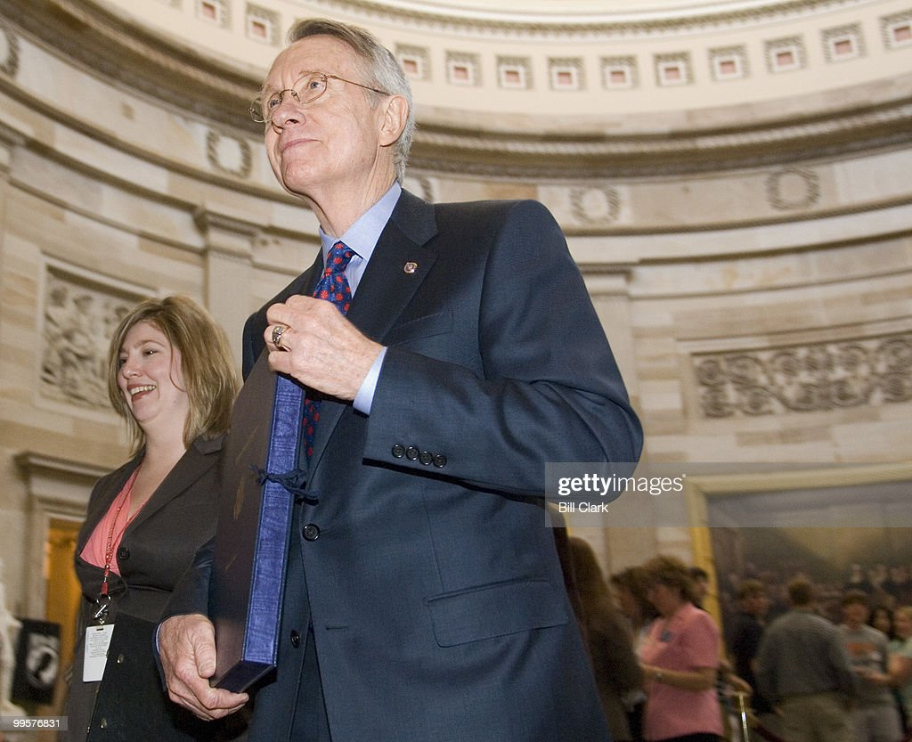 Senate Majority Leader Harry Reid carries the enrollment papers for the Iraq Supplemental Appropriations Bill through the Rotunda on his way to the signing ceremony with Speaker of the House Nancy Pelosi on Tuesday, May 1, 2007.