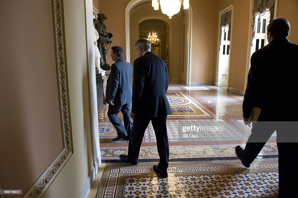 Senate Majority Leader Harry Reid, center, heads to the Senate Democratic Policy lunch in the Mansfield Room of the Capitol on Tuesday, March 17, 2009.