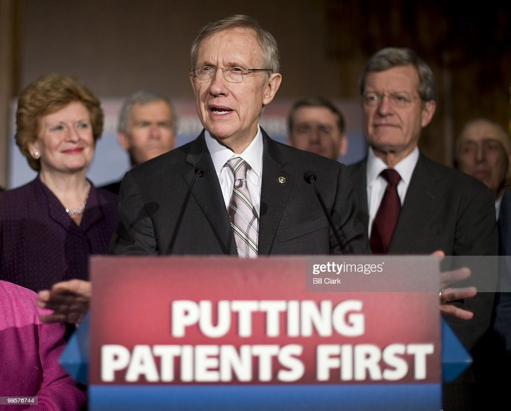 Senate Majority Leader Harry Reid, D-Nev., flanked by other Senate Democrats, including Sens. Debbie Stabenow and Max Baucus speaks during the Democrats' news conference following the passage of the healthcare reconciliation bill on Thursday, March 25, 2010.
