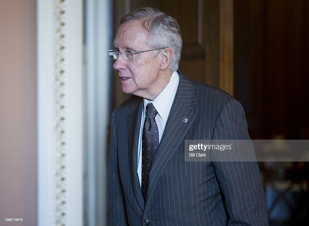Senate Majority Leader Harry Reid, D-Nev., heads to the Ohio Clock Corridor to speak with reporters following the Senate Democrats' policy lunch in the Capitol on Tuesday, Dec. 11, 2012.