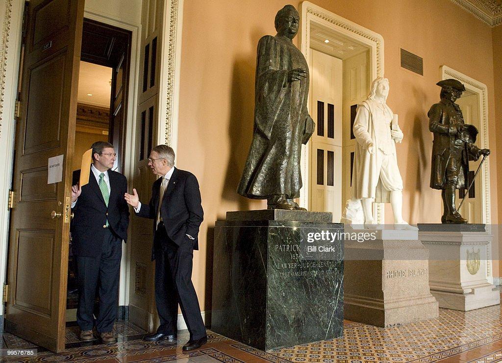 Senate Majority Leader Harry Reid, D-Nev., right, speaks with Sen. Byron Dorgan, D-N. Dak., as the Senate Democratic Policy lunch breaks up on Tuesday, Feb. 3, 2009.