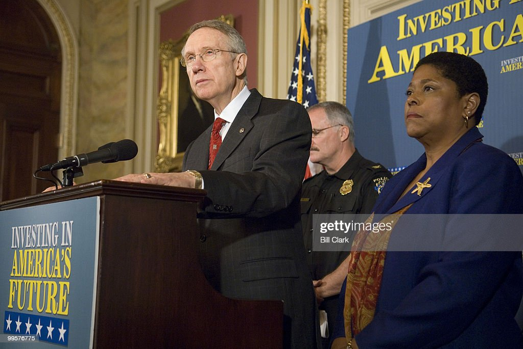 Senate Majority Leader Harry Reid, D-Nev., speaks as Marsha Smith, health and physical education teacher and team leader at Earle Wood Middle School in Rockville, Md., listens during the news conference to discuss President Bush's threats to veto appropriations bills on Weednesday, Oct. 24, 2007.