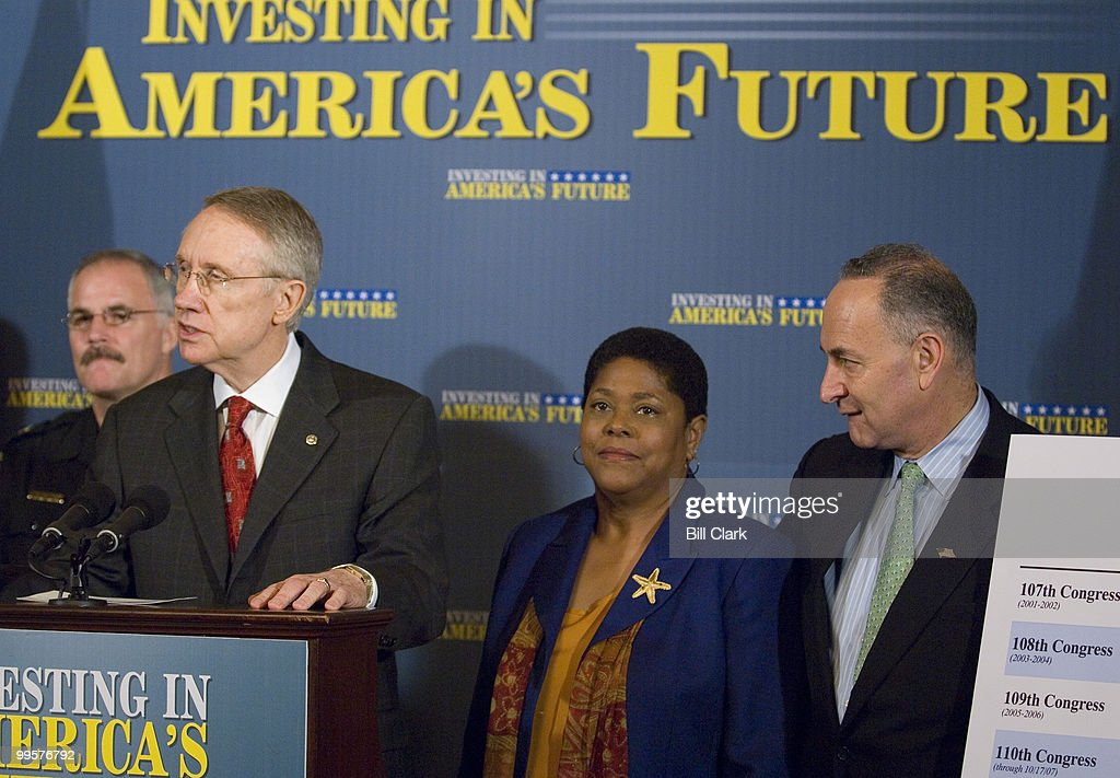 Senate Majority Leader Harry Reid, D-Nev., speaks as Marsha Smith, health and physical education teacher and team leader at Earle Wood Middle School in Rockville, Md., and Sen. Charles Schumer, D-N.Y., listen during the news conference to discuss President Bush's threats to veto appropriations bills on Weednesday, Oct. 24, 2007.