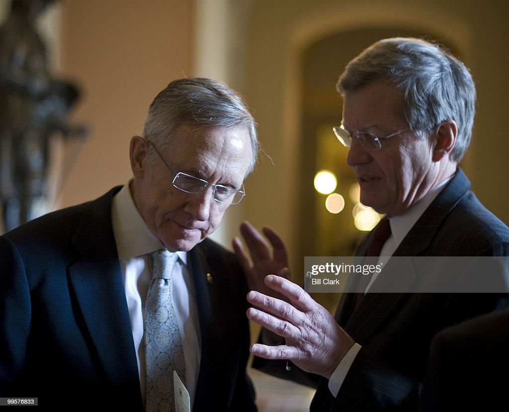 Senate Majority Leader Harry Reid, D-Nev., speaks with Sen. Max Baucus, D-Mont., as they leave the Senate Democrats' weekly lunch meeting on Tuesday, March 23, 2010.