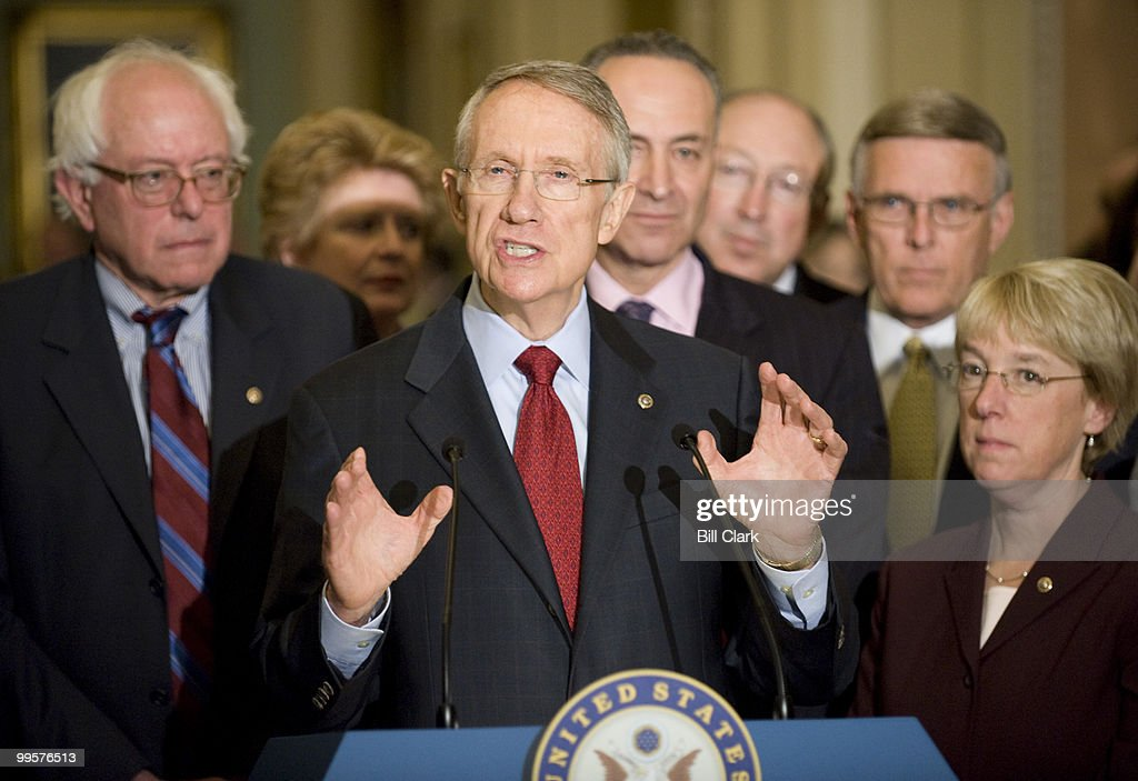 Senate Majority Leader Harry Reid, D-Nev., surrounded from left by , Sen. Bernie Sanders, I-Vt., Sen. Debbie Stabenow, D-Mich., Sen. Charles Schumer, D-N.Y., Sen. Ken Salazar, D-Colo., Sen. Byron Dorgan, D-N. Dak., and Sen. Patty Murray, D-Wash., speak to the media in the Ohio Clock Corridor of the Capitol following the weekly Senate Democratic Policy luncheon on Wednesday, May 7, 2008.