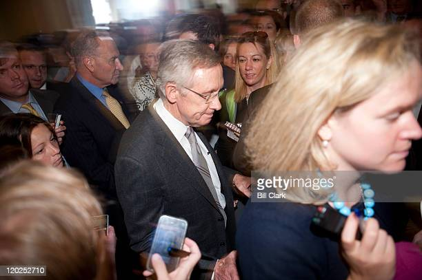 Senate Majority Leader Harry Reid DNev wades through a throng of reporters following his news conference on the Senate vote to raise the debt limit...