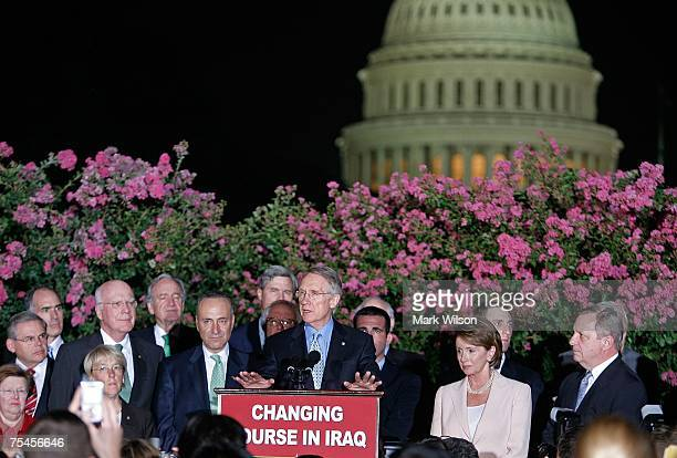 Senate Majority Leader Harry Reid flanked by House of Representatives Nancy Pelosi Sen Charles Schumer and other members of Congress speaks during a...