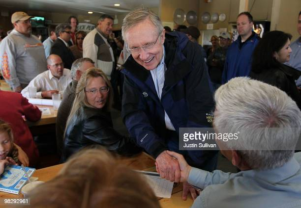 S Senate Majority Leader Harry Reid greets patrons at TJ's Pizza Shack April 6 2010 in Fernley Nevada Sen Reid continues his three day bus tour...