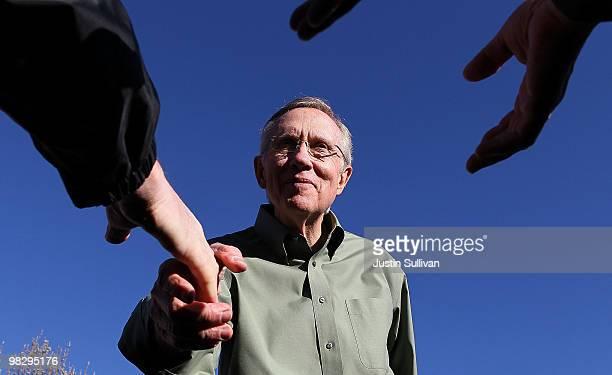S Senate Majority Leader Harry Reid greets supporters during a rally at University of NevadaReno April 6 2010 in Reno Nevada Sen Reid continues his...