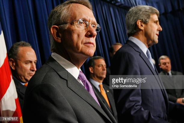 Senate Majority Leader Harry Reid holds a news conference with other Democratic leaders including Sen Charles Schumer Sen Russell Feingold Sen John...