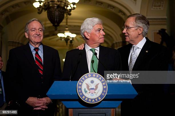 Senate Majority Leader Harry Reid hugs Sen Chris Dodd as Sen Tom Harkin looks on during a news conference following the Senate's cloture vote on...