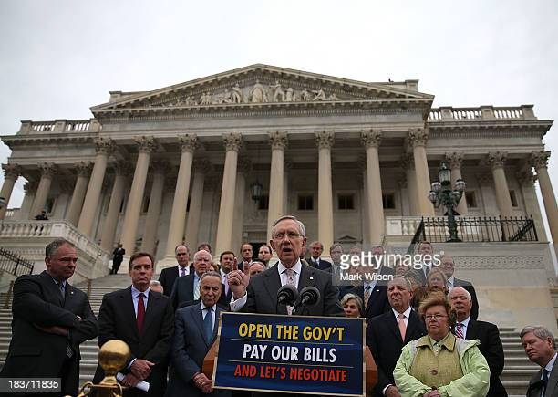 Senate Majority Leader Harry Reid is flanked by Senate Democrats during a news conference on the government shutdown at the US Capitol October 9 2013...