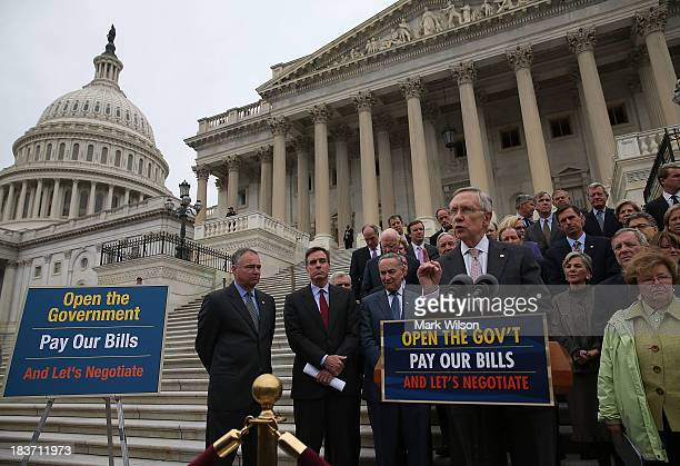 Senate Majority Leader Harry Reid is flanked by Senate Democrats as he speaks to the media during a news conference on the government shutdown at the...
