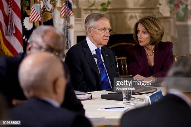 Senate Majority Leader Harry Reid of Nev talks to House Speaker Nancy Pelosi of Calif during a health care reform meeting with President Barack Obama...