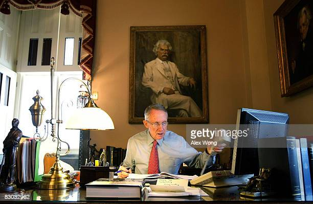 S Senate Majority Leader Harry Reid put his phone down as he works in office during a rare Saturday session on Capitol Hill September 27 2008 in...