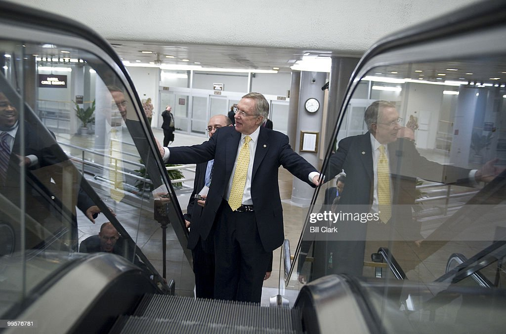 Senate Majority Leader Harry Reid rides the escalator from the CVC, where he held a news conference on veterans' health care, on Tuesday, Nov. 10, 2009.