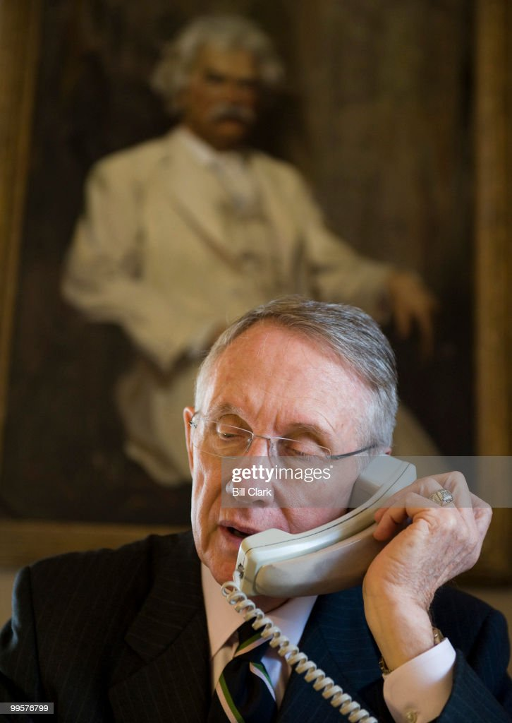Senate Majority Leader Harry Reid, R-Nev., talks about the financial bailout on the phone at his desk in the Capitol on Thursday, Oct. 02, 2008.